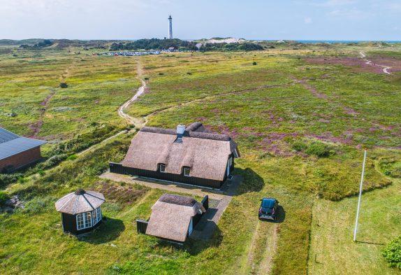 Charmantes Reetdachhaus mit Blick auf den Leuchtturm