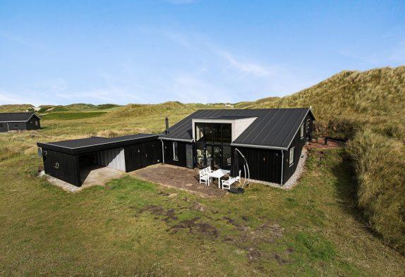 Charmantes Holzhaus in fantastischer, strandnaher Lage