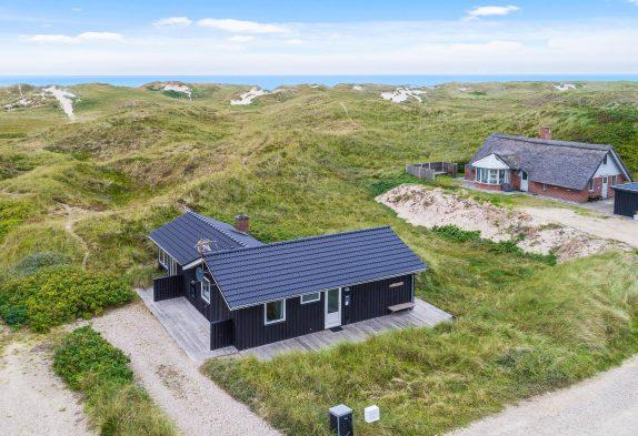 Gemütliches Ferienhaus mitten in den Dünen, 300 m bis zum Strand