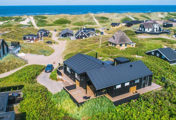 Schickes Ferienhaus mit Aussensauna, Aussenwhirlpool & Meerblick